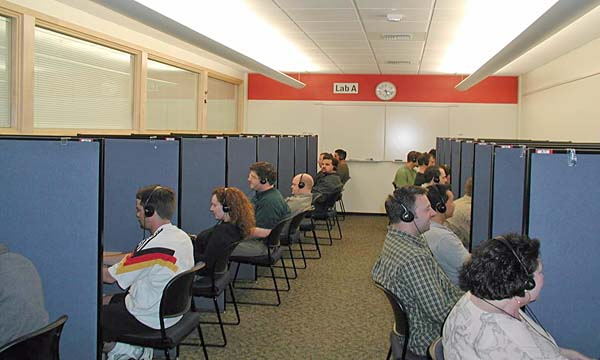 Photo of a row of test cubicles with game players at Microsoft Games Studios